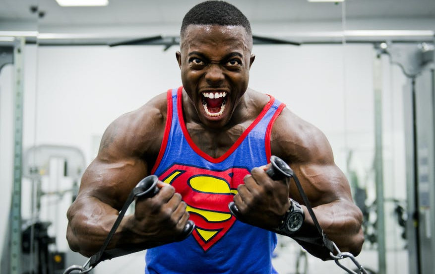 man in superman t shirt working out