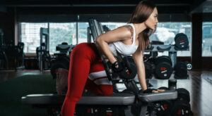 woman performing bent over rows